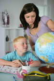 Woman giving her son a geography lesson — Stock Photo