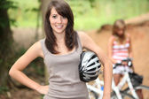 Teenage girls on a bike ride — Stockfoto