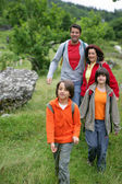 Young family hiking — Stock Photo