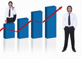 Confident businessman on white background with chart of growing profits — Stock Photo