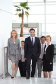 Businesspeople walking through an airport — Stock Photo