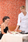 Waitress serving a meal — Stock Photo