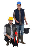 Two manual workers collaborating — Stock Photo