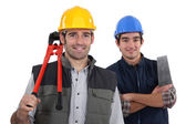 Craftsman and apprentice posing together — Stock Photo