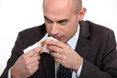 Bad man smelling money — Stock Photo
