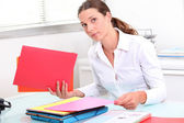 Young woman classifying documents — Stock Photo
