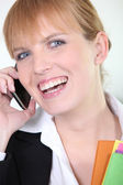 Woman laughing on her cellphone — Stock Photo