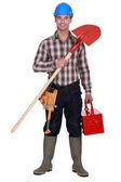 Manual worker holding spade — Стоковое фото