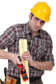 Craftsman rasping a board — Stock Photo