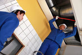 Workers working on air conditioning — Stock Photo