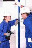 Electricians chatting on the job — Stock Photo