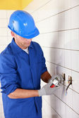 Electrician connecting an electrical outlet — Stock Photo
