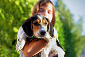 A child holding a dog — Stockfoto