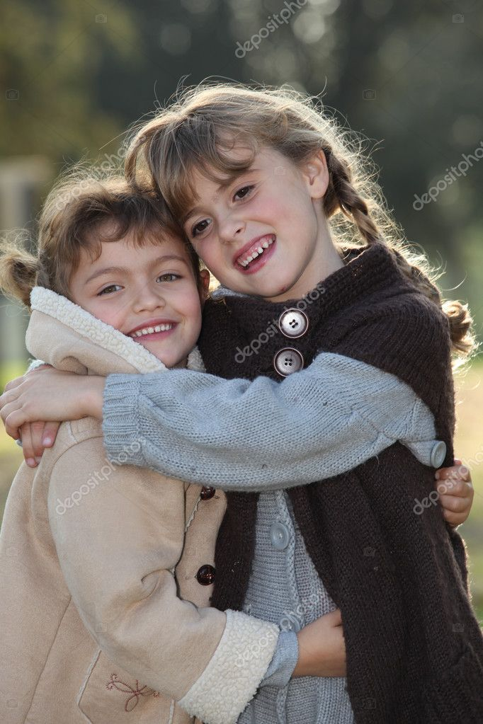 Tender scene of two little girls hugging — Stock Photo #8530860