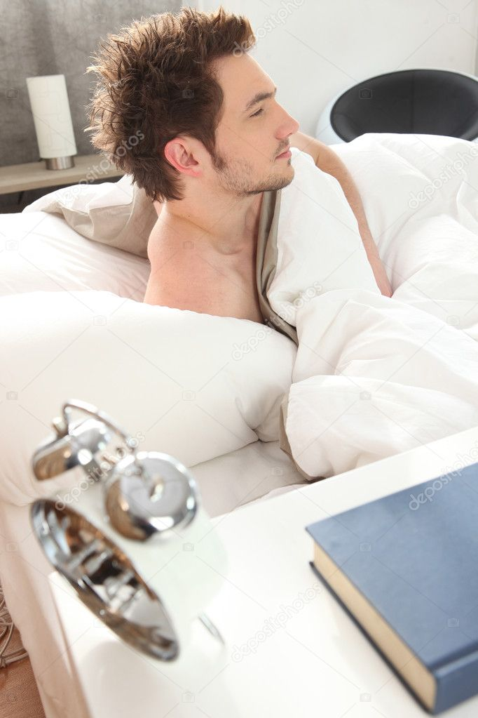 Man waking up in his bed — Stock Photo #8537982