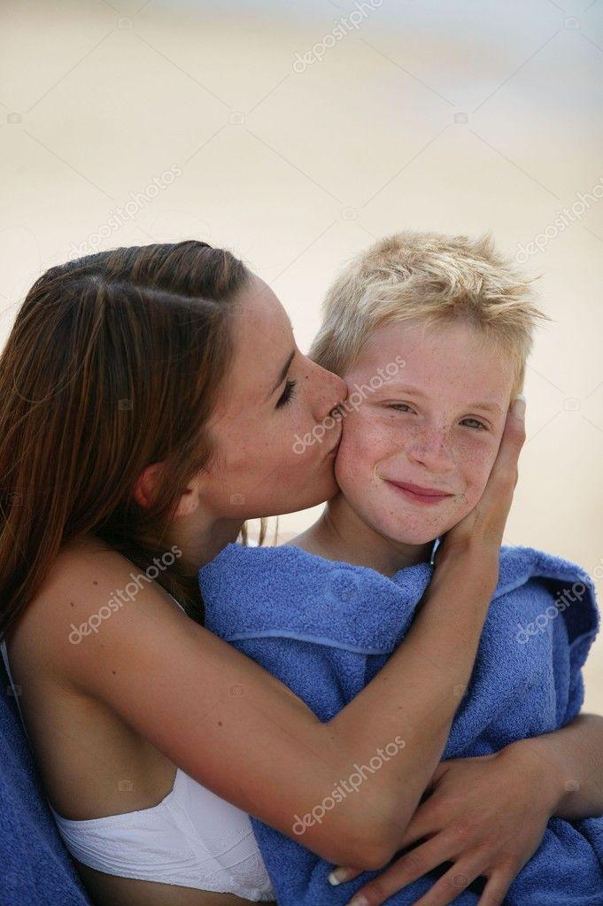 Older women kissing girls
