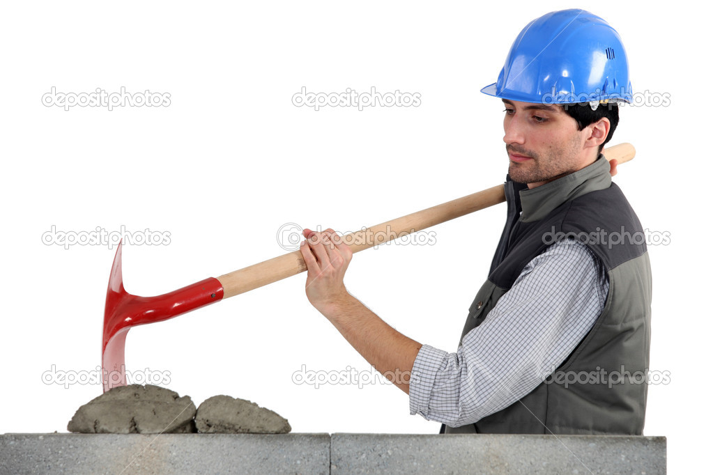 Worker with spade and cement — Stock Photo #8539645