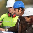 Stock Photo: Contractors discussing a project