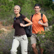 Stock Photo: Young couple hiking through the woods