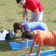 Stock Photo: Personal trainer helping his client