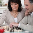 Couple playing chess together - Stock Photo