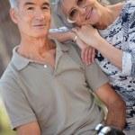 Senior couple riding bikes — Stock Photo #8543221