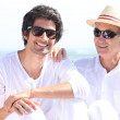 Father and son on the beach — Stock Photo