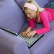 Little girl using a laptop — Stock Photo