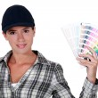 Girl showing a swatches — Stock Photo