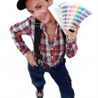 Stock Photo: Womdisplaying paint colour samples