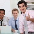 Male trio in meeting room with laptop — Stock Photo