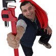 Plumber with adjustable wrench — Stock Photo #8546937