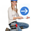 Pretty blonde apprentice showing direction of construction site — Stock Photo