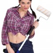 Stock Photo: Sexy craftswoman painter holding a roller brush