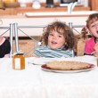Children eating a pie — Stock Photo