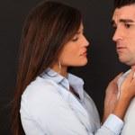 Woman grabbing mans collar — Stock Photo