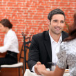 Couple eating in a restaurant - Stock Photo