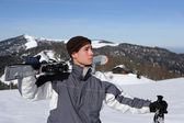 Boy with skis on shoulder — Stock Photo