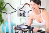 Young brunette doing fitness in a fitness center — Stock Photo