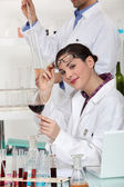 Experts testing wine in a laboratory — Stock Photo