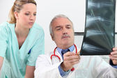 Doctor and his assistant — Stock Photo