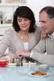 Couple playing chess together — Stock Photo