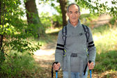 Elderly person hiking — Stock Photo