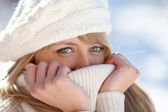 Blonde wrapped in pullover by cold weather — Stock Photo
