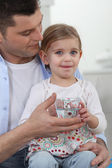 Man with little girl drinking glass of water — Stock Photo