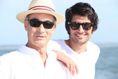 Father and son on holiday abroad — Stock Photo