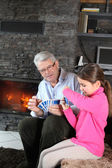 Little girl playing card game with granddad — Foto Stock