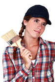 Young painter with a brush — Stock Photo