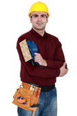 Tradesman holding a sander — Stock Photo