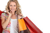 Woman with numerous shopping bags — Stock Photo